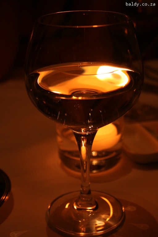 Candle light effects on a wine glass